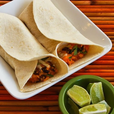 Slow Cooker Recipe for Sweet Potato and Black Bean Burritos with Lime from Kalyn's Kitchen featured on SlowCookerFromScratch.com