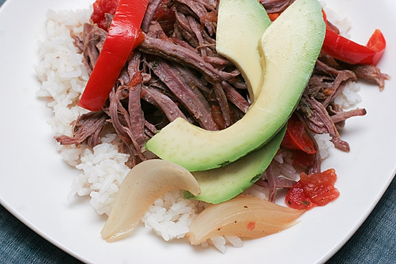 Slow Cooker Cuban Braised Beef and Peppers from Taste and Tell featured on Slow Cooker or Pressure Cooker at SlowCookerFromScratch.com