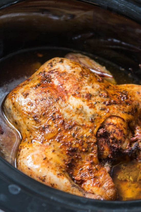 Tender Slow Cooker Whole Chicken from Oh Sweet Basil featured on Slow Cooker or Pressure Cooker at SlowCookerFromScratch.com