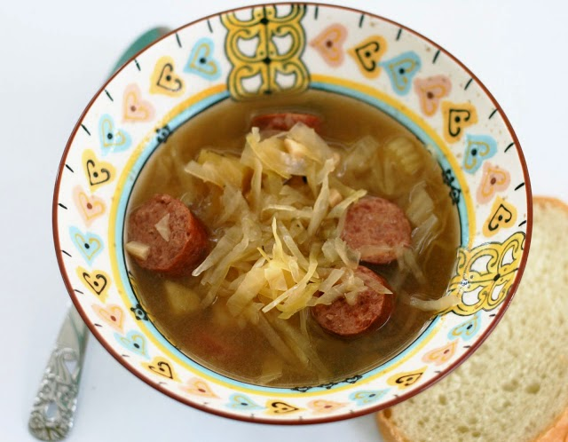 Slow Cooker Sauerkraut Soup with Kielbasa from Coconut and Lime featured on SlowCookerFromScratch.com