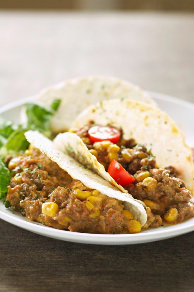 Crockpot Cheesy Beef Tacos from Slow Cooker Gourmet featured on SlowCookerFromScratch.com