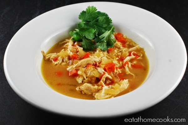 Easy Slow Cooker Thai Chicken Curry Soup from Eat at Home featured on SlowCookerFromScratch.com