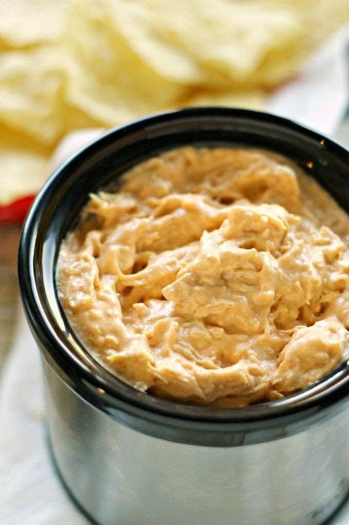 Crockpot Honey Sriracha Chicken Dip from Crockpot Gourmet featured on SlowCookerFromScratch.com