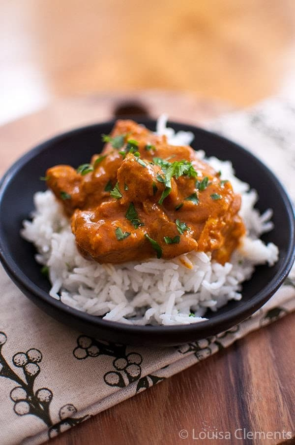 Slow Cooker Butter Chicken from Living Lou featured on SlowCookerFromScratch.com
