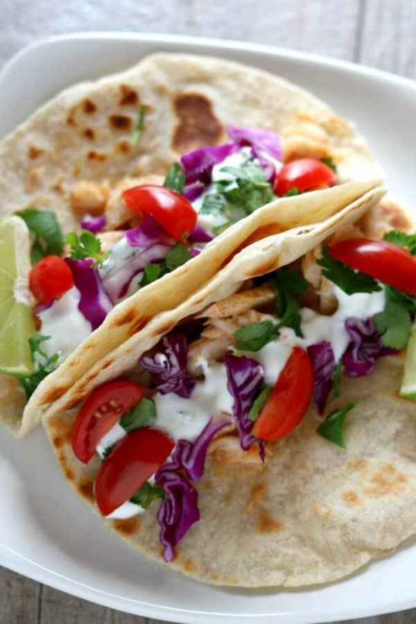 Alaska Cod Fish Tacos with Garlic Lime Sour Cream from 365 Days of Slow + Pressure Cooking