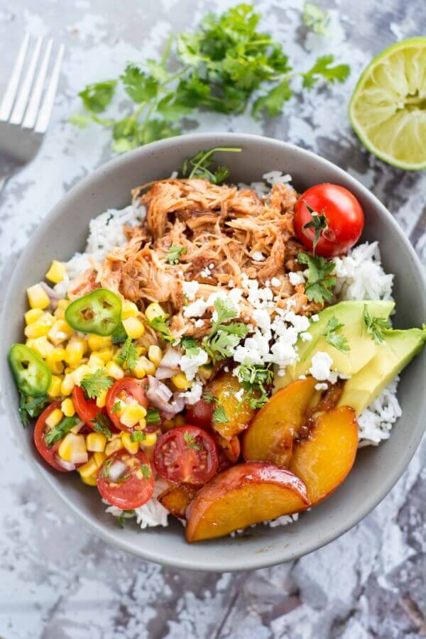 Slow Cooker Peach Jalapeno Chicken Bowls from Slow Cooker Gourmet featured on SlowCookerFromScratch.com