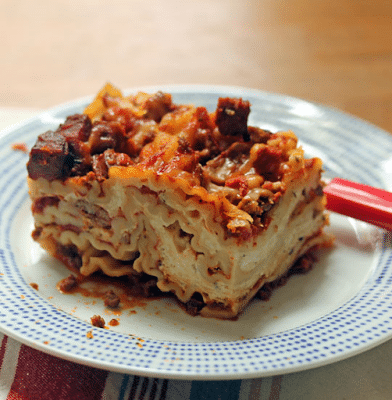 Slow Cooker Sausage and Four Cheese Lasagna from The Perfect Pantry [featured on SlowCookerFromScratch.com]