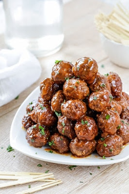 Slow Cooker Honey Buffalo Meatballs from Carlsbad Cravings featured on SlowCookerFromScratch.com