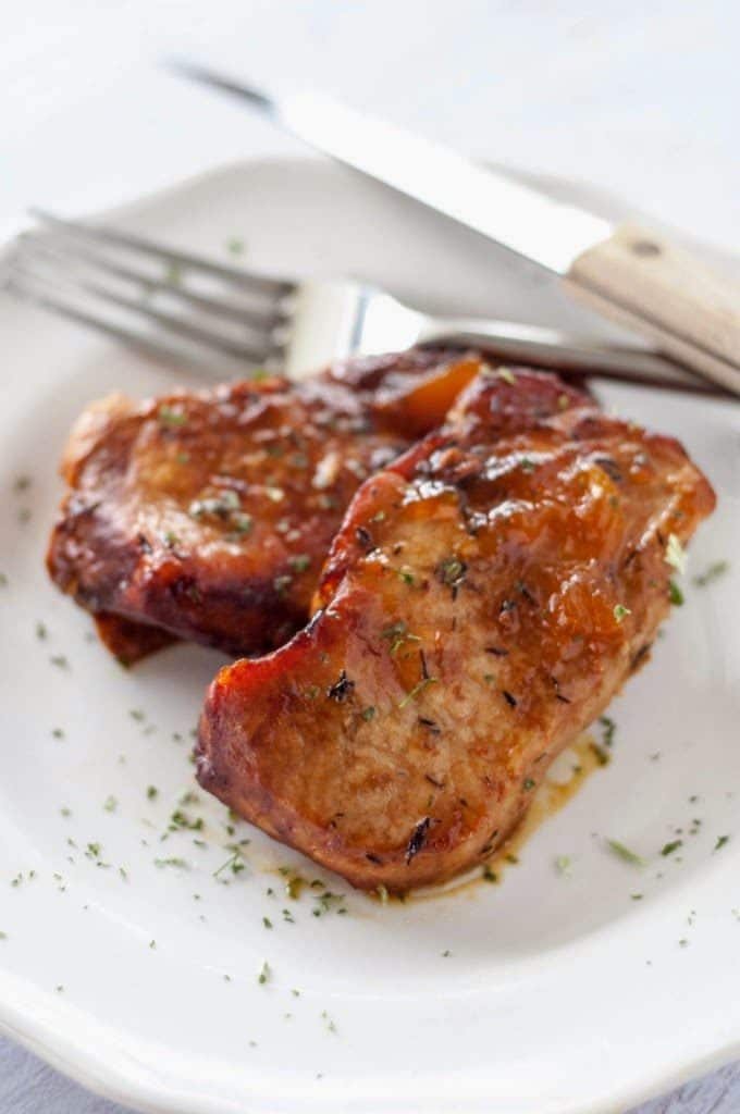 Crockpot Peach Glazed Pork Chops from Slow Cooker Gourmet featured on SlowCookerFromScratch.com
