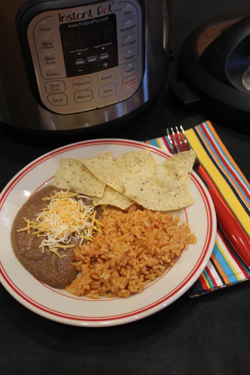 The BEST Slow Cooker or Instant Pot Refried Beans from Food Bloggers found on SlowCookerFromScratch.com