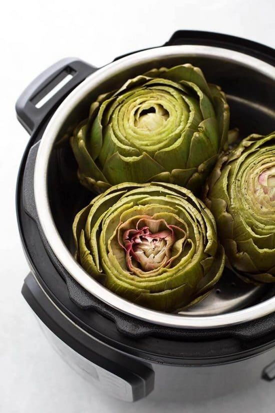 How to Cook Artichokes in the Slow Cooker or Instant Pot found on Slow Cooker or Pressure Cooker at SlowCookerFromScratch.com