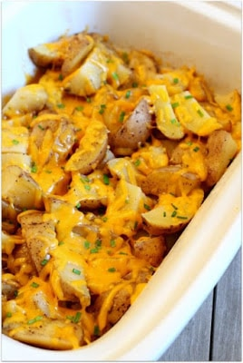 Slow Cooker Cheesy Potatoes and Chives from 365 Days of Slow Cooking featured on SlowCookerFromScratch.com