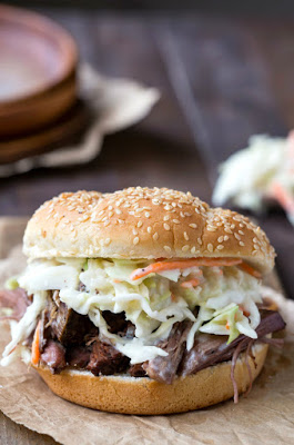 The BEST Slow Cooker Barbecued Beef Sandwiches with Homemade Sauce featured on SlowCookerFromScratch.com