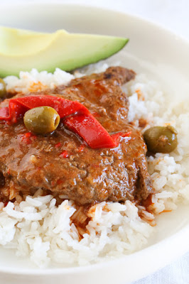 Braised, Cubed Steak with Peppers and Olives for Instant Pot, Slow Cooker, or Stove Top from SkinnyTaste featured on SlowCookerFromScratch.com
