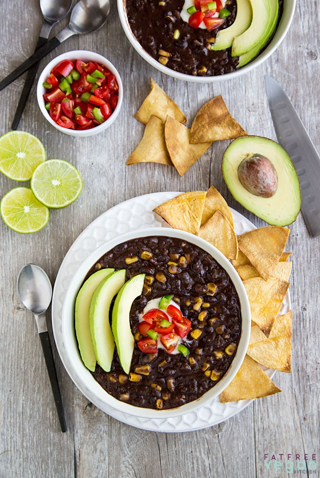 Simple Instant Pot Black Bean Soup from Fat Free Vegan Kitchen finished soup in bowl with garnishes