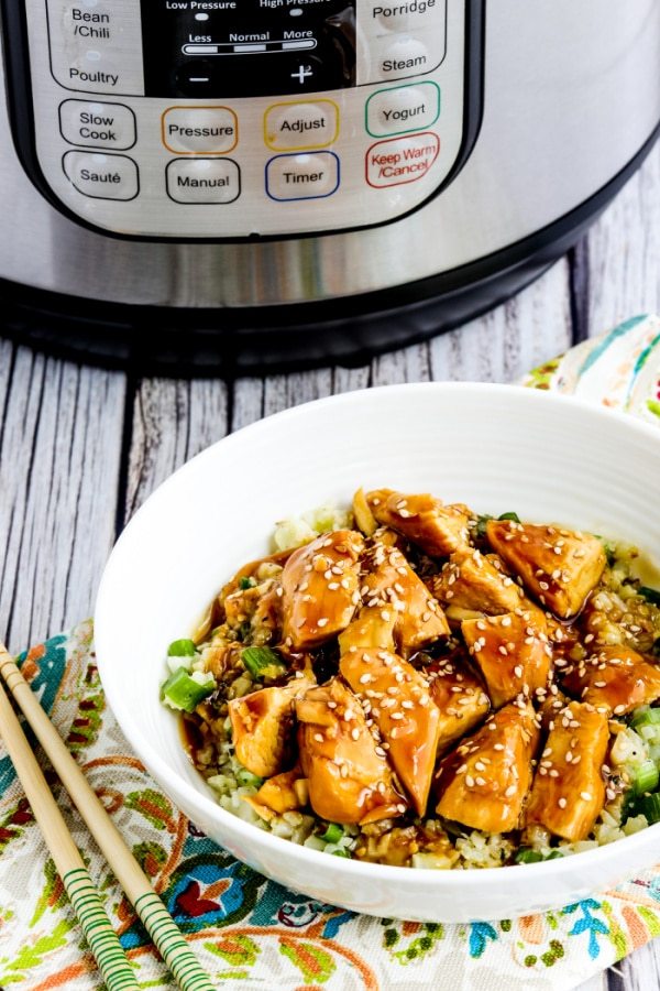 Instant Pot Teriyaki Chicken with Teriyaki Chicken rice bowl shown in front of Instant Pot