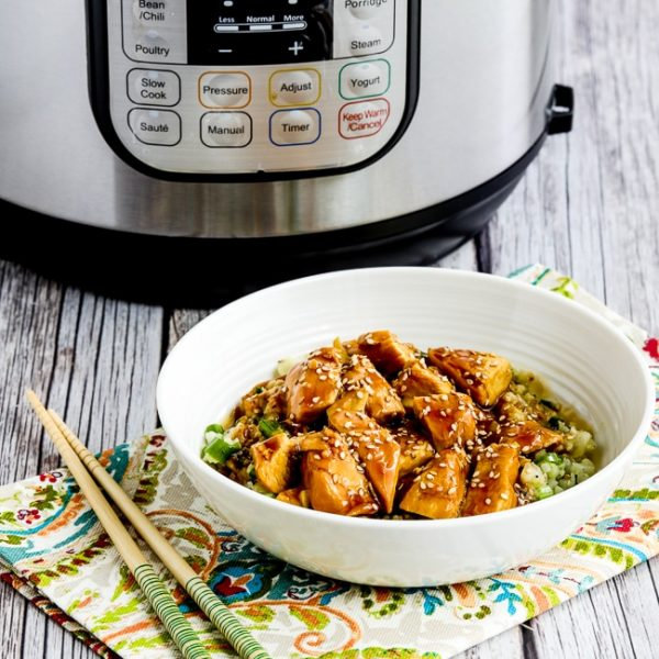 Instant Pot Teriyaki Chicken thumbnail image of chicken over cauliflower rice with Instant Pot in back